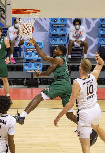 Ohio guard Lunden McDay (15) shoots an off-balanced shot and scores during the first half of a first-round game against Virginia in the NCAA men's college basketball tournament, Saturday, March 20, 2021, at Assembly Hall in Bloomington, Ind. (AP Photo/Doug McSchooler)