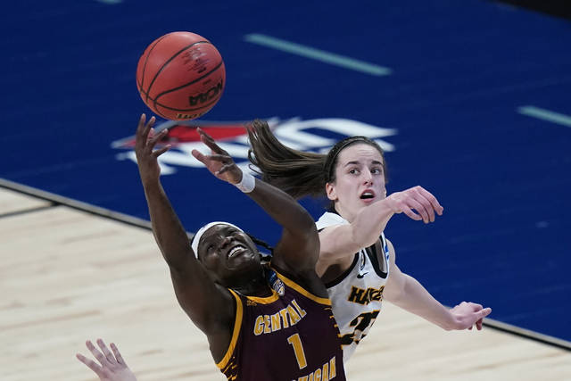 Central Michigan guard Micaela Kelly (1) fights for a rebound with Iowa guard Caitlin Clark, right, during the second half of a college basketball game in the first round of the women's NCAA tournament at the Alamodome, Sunday, March 21, 2021, in San Antonio. (AP Photo/Eric Gay)