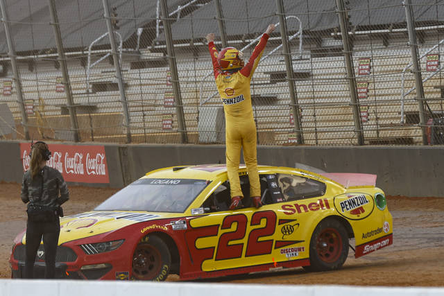 Joey Logano celebrates after winning a NASCAR Cup Series auto race, Monday, March 29, 2021, in Bristol, Tenn. (AP Photo/Wade Payne)