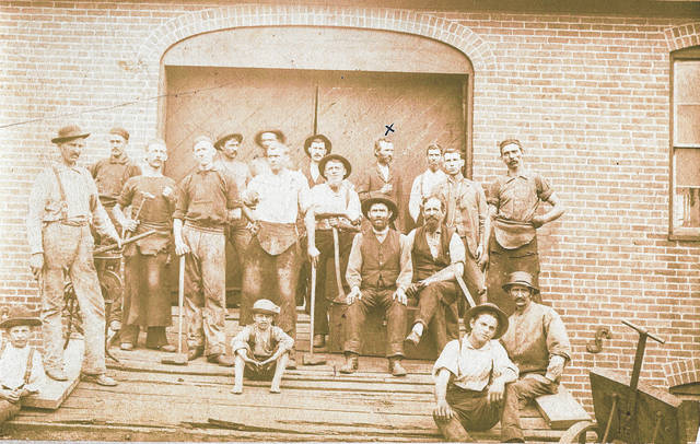 Champion Bridge Workers about 1880. Among those shown are: fourth from left standing is Joe Merrimam; seated on a box with hat on is Mr. Moore, who ran the foundry; at the platform at right is Linneas Ellis. Can you tell us more? Share it at info@wnewsj.com. The photo is courtesy of the Clinton County Historical Society. Like this image? Reproduction copies of this photo are available by calling the History Center. For more info, visit www.clintoncountyhistory.org; follow them on Facebook @ClintonCountyHistory; or call 937-382-4684.