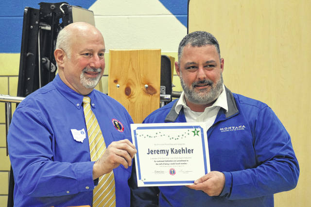 """Blanchester School Board member Jeremy Kaehler, right, receives an award from Mike Ewing of the Southwest Ohio School Board Association at Monday's board meeting. The award is in recognition for """"continued dedication and commitment to the craft of being a model board member."""""""