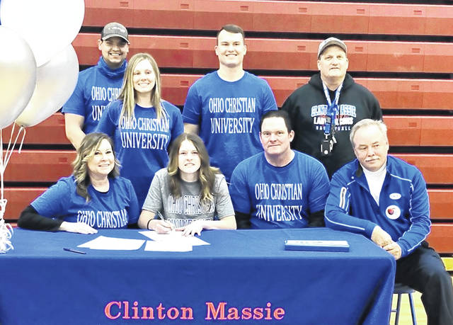 Clinton-Massie senior McKenzie Avery has signed to play college basketball with Ohio Christian University. The NAIA institution is located in Circleville. In the photo, from left to right, front row, mother Nicole Avery, McKenzie Avery, father Andy Avery and Ohio Christian assistant coach Bob Williams; back row, brother in law Ryan Weiss, sister Rachel Weiss, brother A.J. Avery and Clinton-Massie head coach Hilma Crawford.
