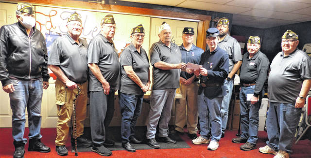 Ron Dunn, Commander of VFW Post 6710, presents a check to Shawn Cox, Patriotic Instructor of Henry Casey Camp 92 Sons of Union Veterans of the Civil War (SUVCW), and Shane Milburn, Secretary of the Henry Casey Camp, to help support the SUVCW's goal of marking the grave site of the last surviving Union Civil War soldier in each Ohio County. Shown from left are Tony Greene, Bob Rich, Brady Stevens, Leslie Rose, Commander Ron Dunn, Shane Milburn, Shawn Cox, Jeff Rollins, Paul Butler, and Charles Rose.