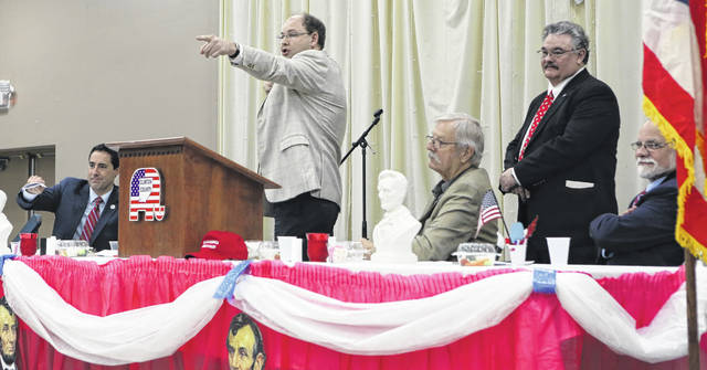 The raffle is always a highlight of the event. From left are Ohio Secretary of State Frank LaRose, Wilmington City Councilman Jonathan McKay (gesturing to the audience), Central Committee Chairman Joe Daugherty, Clinton County GOP Chairman Tim Inwood, and Pastor Dan Mayo.