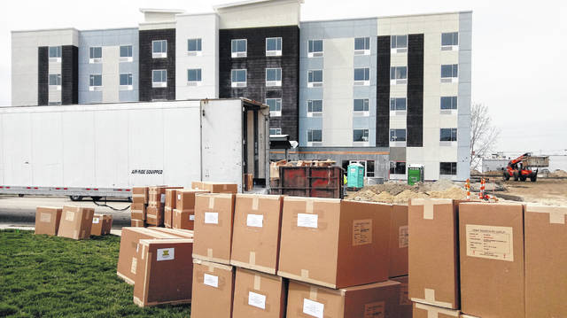 Work continues and a semi-truck full of cabinetry has arrived at the under-construction five-story TownePlace Suites by Marriott on Holiday Drive in Wilmington. The hotel will have 94 guest rooms plus an indoor pool, lounge and meeting spaces. It is on track to open this summer.