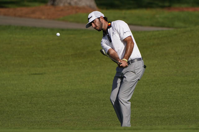 FILE - In this Nov. 13, 2020, file photo, Max Homa chips to the second green during the second round of the Masters golf tournament in Augusta, Ga. Homa expects a different Augusta National in April. (AP Photo/Chris Carlson, File)
