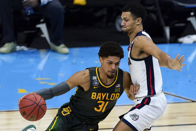 Baylor guard MaCio Teague (31) drives around Gonzaga guard Jalen Suggs, right, during the second half of the championship game in the men's Final Four NCAA college basketball tournament, Monday, April 5, 2021, at Lucas Oil Stadium in Indianapolis. (AP Photo/Michael Conroy)