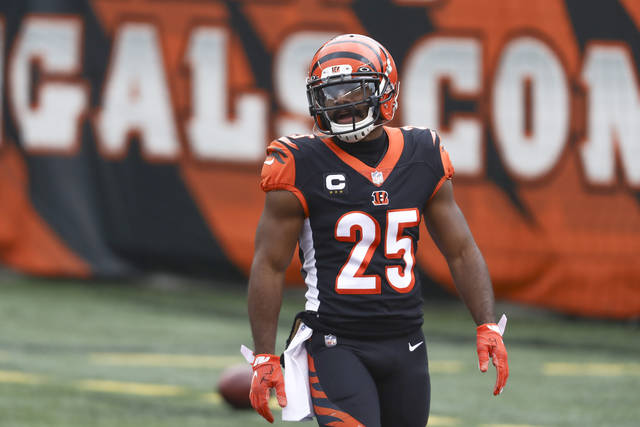 FILE - Cincinnati Bengals running back Giovani Bernard (25) warms up before an NFL football game against the Baltimore Ravens in Cincinnati, in this Sunday, Jan. 3, 2021, file photo. The Bengals continued to part with veterans when they released running back Giovani Bernard on Wednesday, April 7, 2021. Bernard, a free agent, played his entire eight-year NFL career in Cincinnati and established himself as a reliable blocking back and receiver.(AP Photo/Aaron Doster, File)