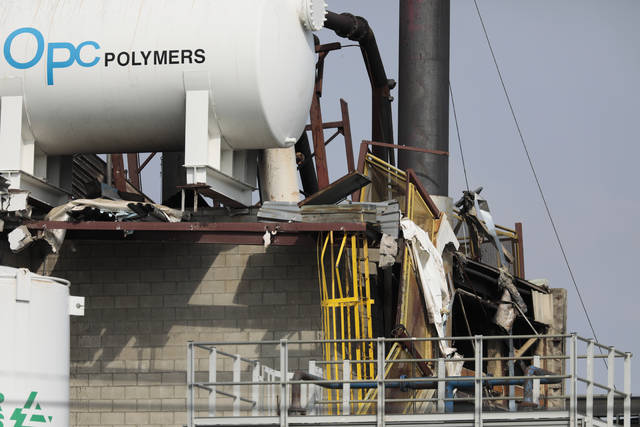 Damage is seen following an overnight explosion at the Yenkin-Majestic Paint plant, Thursday, April 8, 2021, in Columbus, Ohio. One person was killed and multiple others were injured in an explosion and fire Thursday at the paint manufacturer's plant in Ohio's capital city, firefighters said. Authorities in Columbus were investigating what caused the explosion shortly after midnight at the paint facility. (Joshua A. Bickel/The Columbus Dispatch via AP)