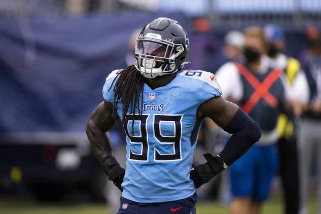 FILE - Tennessee Titans outside linebacker Jadeveon Clowney (99) pauses between plays against the Pittsburgh Steelers during the first half of an NFL football game in Nashville, in this Sunday, Oct. 25, 2020, file photo. Clowney will chase quarterbacks and a Super Bowl title with the Browns. The dynamic free agent defensive end signed a one-year, $10 million contract with Cleveland on Wednesday, April 14, 2021. (AP Photo/Brett Carlsen, File)