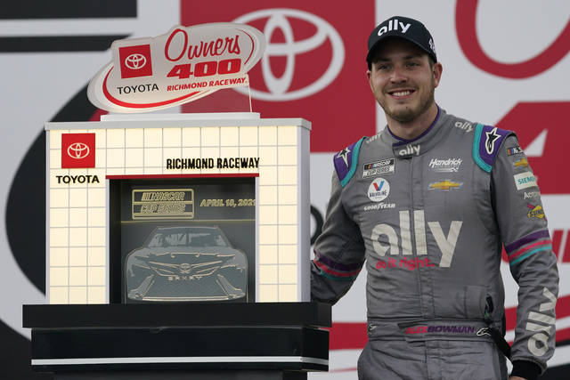 Alex Bowman poses with the trophy as he celebrates winning the NASCAR Cup Series auto race at Richmond International Raceway in Richmond, Va., Sunday, April 18, 2021. (AP Photo/Steve Helber)