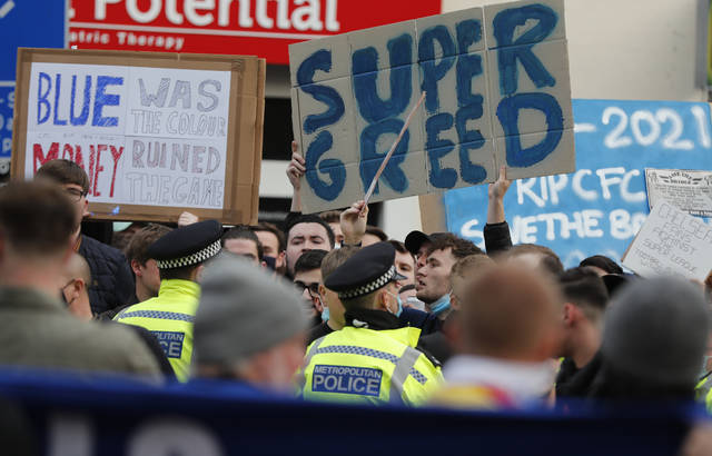 Chelsea fans protest against Chelsea's decision to be included amongst the clubs attempting to form a new European Super League before the English Premier League soccer match between Chelsea and Brighton and Hove Albion outside Stamford Bridge stadium in London, Tuesday, April 20, 2021. (AP Photo/Frank Augstein,Pool)