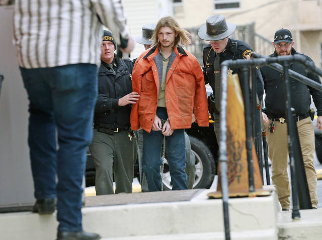 """FILE - This Tuesday, Nov. 27, 2018 file photo shows Edward """"Jake"""" Wagner being escorted by police into the holding area in the Pike County Common Pleas Court in Waverly, Ohio. Wagner planned to plead guilty to eight counts of aggravated murder. In exchange, prosecutors have dropped the possibility of a death sentence, Thursday, April 22, 2021. (Brooke LaValley/The Columbus Dispatch via AP, File)"""