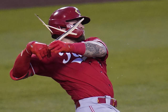 Cincinnati Reds Tucker Barnhart (16) breaks a bat as he grounds out during the second inning of a baseball game against the Los Angeles Dodgers Tuesday, April 27, 2021, in Los Angeles. (AP Photo/Ashley Landis)
