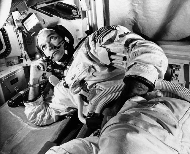 FILE - In this June 19, 1969 file photo, Apollo 11 command module pilot astronaut Michael Collins takes a break during training for the moon mission, in Cape Kennedy, Fla. Collins, who piloted the ship from which Neil Armstrong and Buzz Aldrin left to make their historic first steps on the moon in 1969, died Wednesday, April 28, 2021, of cancer, his family said. He was 90. (AP Photo/File)