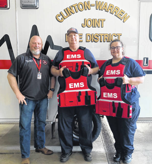 From left are EMA Director Thomas Breckel and, from the Clinton-Warren Joint Fire District, Chief Bob Wysong and Kayla Conger.