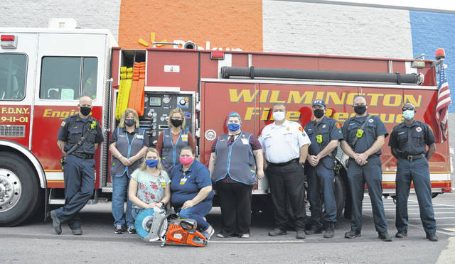 The Wilmington Fire Department was awarded a rescue saw from Walmart as part of a Walmart community involvement grant. Valued at $2,195, Wilmington Fire Chief Andy Mason said they will be able to cut through all sorts of things with it. A Walmart spokesperson said they appreciate the Wilmington Fire Department and look forward to helping them again in the future. Several WFD members and several Walmart employees assembled for the photo, with the new rescue saw in the foreground.