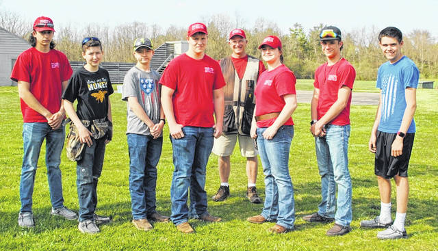 In the photo, from left to right, members of the EC clay target club team, front row, Evan Stewart, Gabe Stewart, Austin Burden, Owen Roberts, Madi Frazer, Aaron Rolfe, and Mitchell Ellis; back row, coach Bruce Warren.