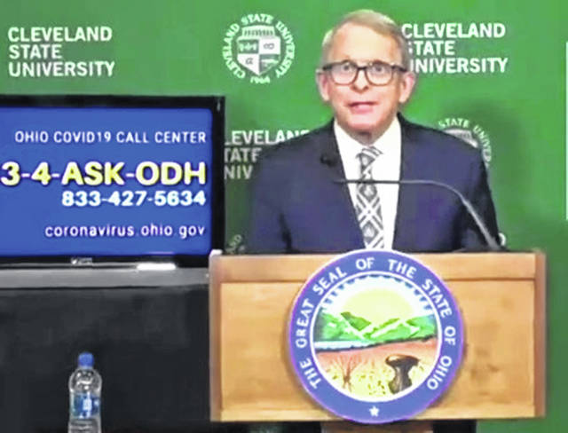 Gov. Mike DeWine speaks from the mass vaccination clinic in Cleveland.