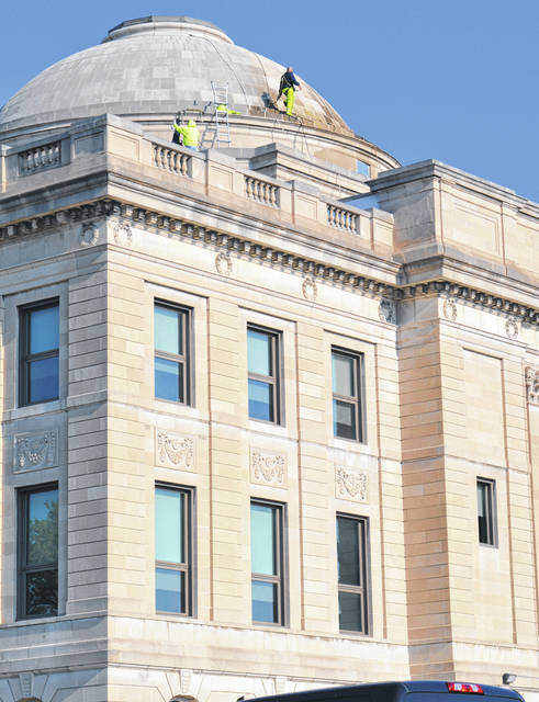 The compact dome of the Clinton County Courthouse received preventive maintenance Monday when workers cleaned, sealed and did minor repairs as needed.