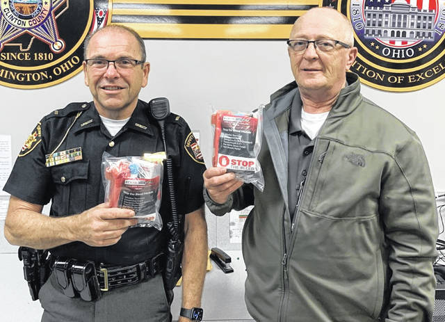 "From left, Clinton County Sheriff's Department Lt. Mike Kassinos and Maj. Brett Prickett each hold a ""Stop the Bleed"" kit provided by Clinton County EMA to local law enforcement."