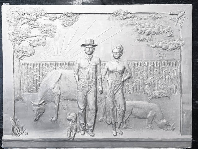 This photo is of a clay relief sculpture that will be cast into bronze and then become a part of a public work of art in Wilmington, paying tribute to the local legacy of agriculture.