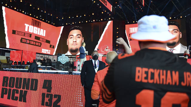 A display screen displayes Cleveland Browns pick Tommy Togiai, a defensive tackle at Ohio State, in the fourth round of the NFL football draft, Saturday, May 1, 2021, in Cleveland. (AP Photo/David Dermer)