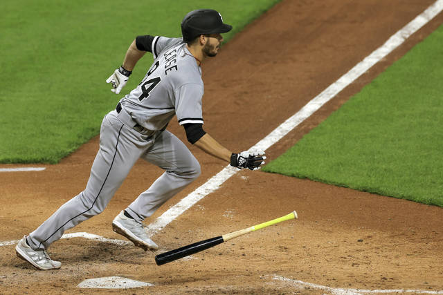 Chicago White Sox Dylan Cease hits for a single during the fifth inning of a baseball game against the Cincinnati Reds, Tuesday, May 4, 2021 in Cincinnati. (AP Photo/Aaron Doster)