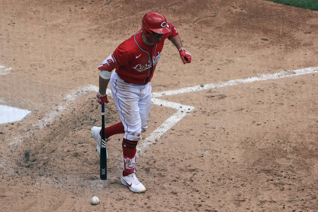 Cincinnati Reds' Joey Votto reacts after being hit by a pitch during the fourth inning of a baseball game against the Chicago White Sox in Cincinnati, Wednesday, May 5, 2021. (AP Photo/Aaron Doster)