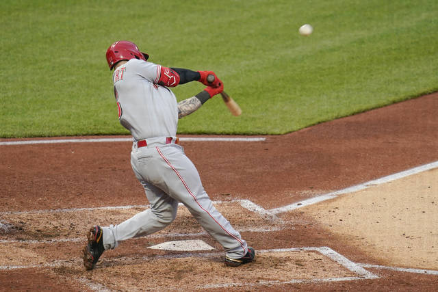 Cincinnati Reds' Tucker Barnhart hits a double to drive in two runs against the Pittsburgh Pirates in the fourth inning of a baseball game, Monday, May 10, 2021, in Pittsburgh. (AP Photo/Keith Srakocic)