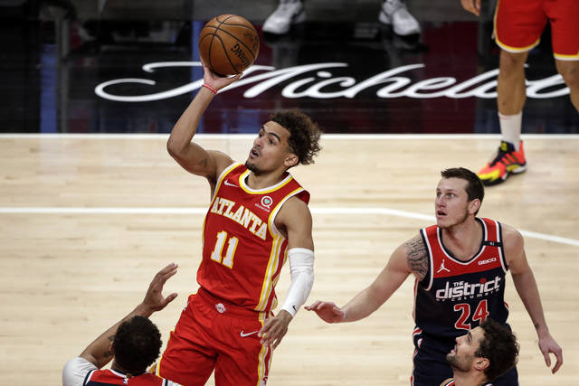 Atlanta Hawks guard Trae Young (11) puts up a shot against the Washington Wizards during the first half of an NBA basketball game Wednesday, May 12, 2021, in Atlanta. (AP Photo/Butch Dill)