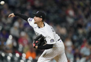 Castillo blasted again as Rockies hold off Reds 13-8