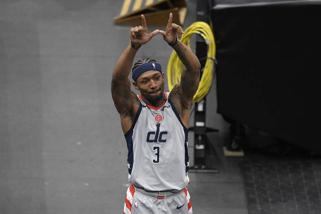 Washington Wizards guard Bradley Beal (3) gestures to the crowd after an NBA basketball game against the Charlotte Hornets, Sunday, May 16, 2021, in Washington. (AP Photo/Nick Wass)