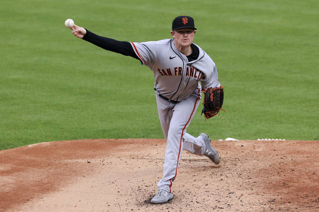 San Francisco Giants' Logan Webb throws during the first inning of a baseball game against the Cincinnati Reds in Cincinnati, Monday, May 17, 2021. (AP Photo/Aaron Doster)
