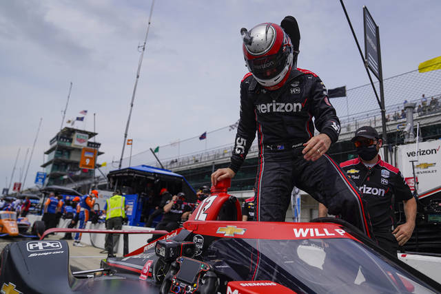 Will Power of Australia climbs into his car during practice for the Indianapolis 500 auto race at Indianapolis Motor Speedway in Indianapolis, Tuesday, May 18, 2021. (AP Photo/Michael Conroy)