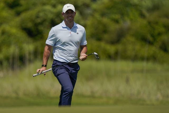 Rory McIlroy, of Northern Ireland, lines up a putt on the 14th hole during a practice round at the PGA Championship golf tournament on the Ocean Course Tuesday, May 18, 2021, in Kiawah Island, S.C. (AP Photo/Matt York)
