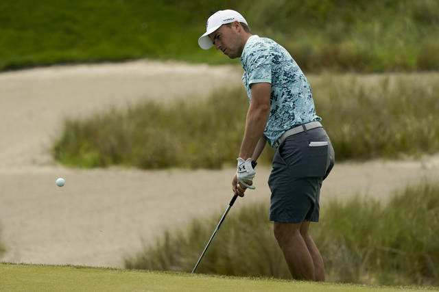 Jordan Spieth chips to the green on the 16th hole during a practice round at the PGA Championship golf tournament on the Ocean Course Tuesday, May 18, 2021, in Kiawah Island, S.C. (AP Photo/Matt York)
