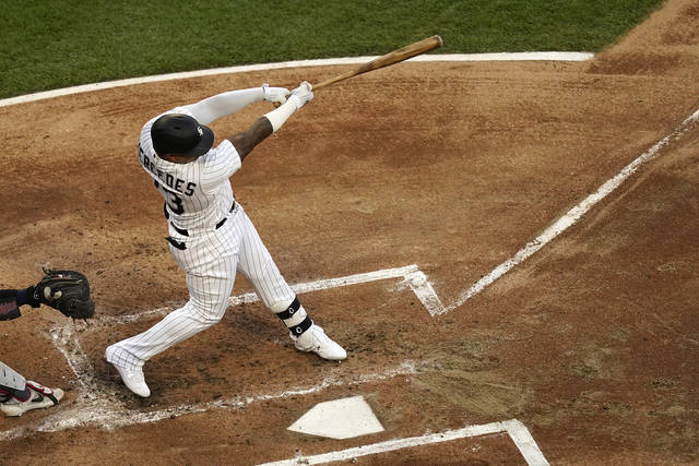 Chicago White Sox's Yermin Mercedes follows through on an RBI single off Minnesota Twins starting pitcher J.A. Happ during the first inning of a baseball game Wednesday, May 12, 2021, in Chicago. (AP Photo/Charles Rex Arbogast)
