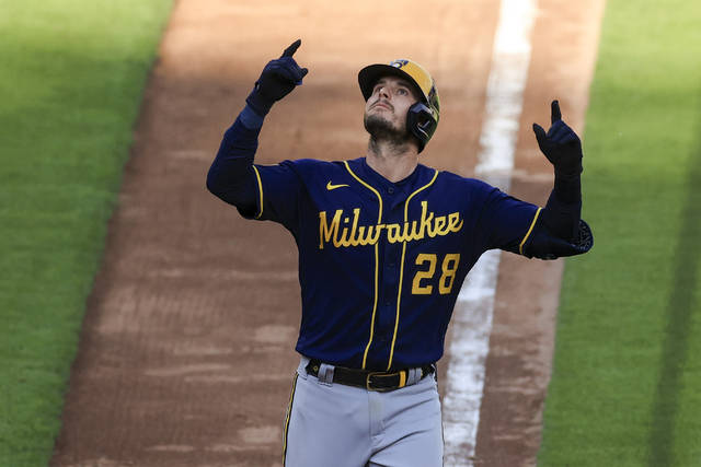 Milwaukee Brewers' Daniel Robertson celebrates hitting a solo home run during the seventh inning of a baseball game against the Cincinnati Reds in Cincinnati, Saturday, May 22, 2021. (AP Photo/Aaron Doster)