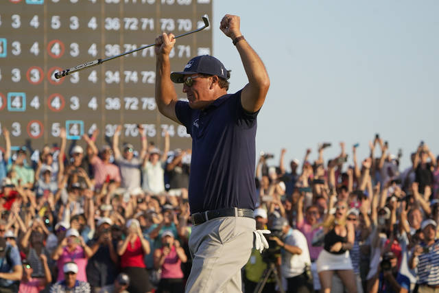 Phil Mickelson celebrates after winning the final round at the PGA Championship golf tournament on the Ocean Course, Sunday, May 23, 2021, in Kiawah Island, S.C. (AP Photo/Chris Carlson)