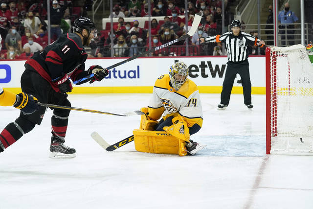 Carolina Hurricanes center Jordan Staal (11) scores against Nashville Predators goaltender Juuse Saros (74) during overtime in Game 5 of an NHL hockey Stanley Cup first-round playoff series in Raleigh, N.C., Tuesday, May 25, 2021. (AP Photo/Gerry Broome)
