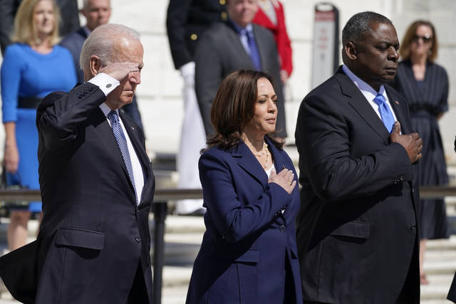President Joe Biden, Vice President Kamala Harris and Defense Secretary Lloyd Austin pause after placing a wreath at the Tomb of the Unknown Soldier in Arlington National Cemetery on Memorial Day, Monday, May 31, 2021, in Arlington, Va.(AP Photo/Alex Brandon)