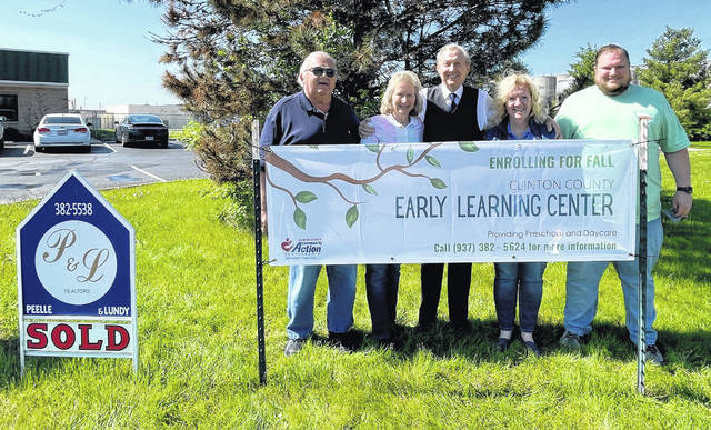 From left are former building owners Larry and Susan Reinsmith, Realtor Butch Peelle of Peelle Lundy & Clifton Realtors, Community Action CEO Jane Newkirk, and Zach Foster, Director of Education Programs Community Action.