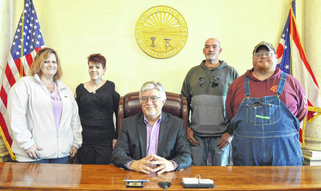 """Looking forward to their imminent drug court graduations are, standing from left, Bambi Klaue, Michele Arledge, Trent Conger and Kyle Hargrave. Not pictured is Mark Allen. Seated in the center is Judge John W. """"Tim"""" Rudduck, who presides over the You-Turn Recovery Docket."""
