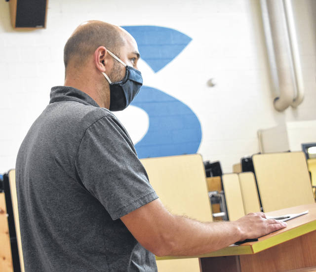 Blanchester Middle School teacher Kurt Ballinger expresses concerns about loosening mask requirements at a special school board meeting on Monday.