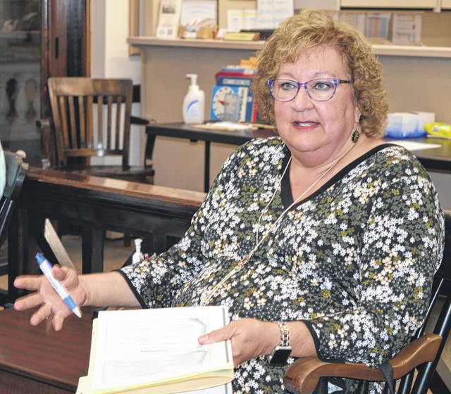 Mental Health Recovery Board Executive Director Colleen Chamberlain speaks Monday with Clinton County commissioners.