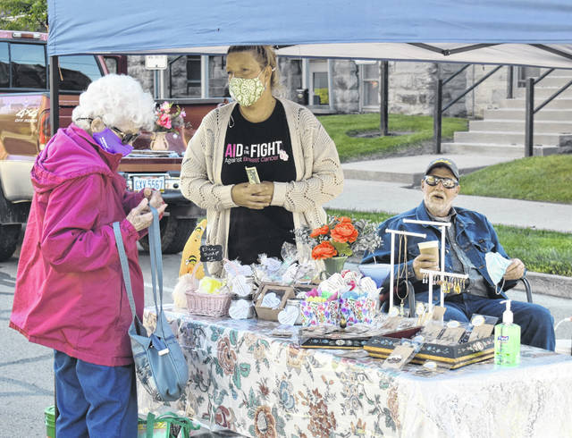 Patrons take a look at the local produce, baked goods, meats, crafts and more (including live music) provided at the opening day of the 2021 Clinton County Farmers Market on Saturday. The market continues this Saturday, May 22 and every Saturday from 8:30 a.m. to noon through Oct. 16 on Mulberry Street (between Locust and Main streets). It will continue to follow recommendations regarding social distancing and wearing of face masks, with a handwashing station. For more info visit the Facebook page, ClintonCountyFarmersMarket .