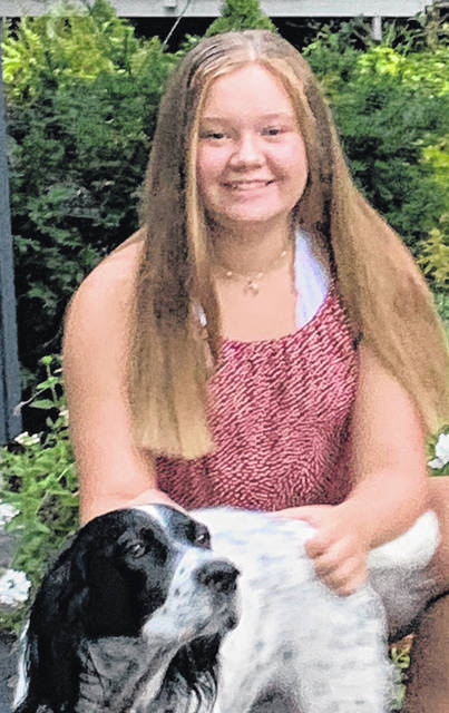 Dariyan DeWeese is pictured with her English setter, Lexi. The eighth-grader will be hosting a golf tournament on June 13 in Baldwinsville, N.Y. for the benefit of K-9 Caring Angels and Therapy Dogs as she works toward earning her Silver Award in the Girl Scouts.