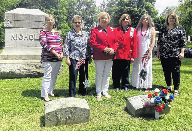 Linda Barkey, Karen McKenzie, Claire Ropp, Susan Henry, Carol Darnell and Amy Miller help decorate the grave of Mrs. Elouisa King Nichols, first Regent of George Clinton Chapter, NSDAR, at Sugar Grove Cemetery.