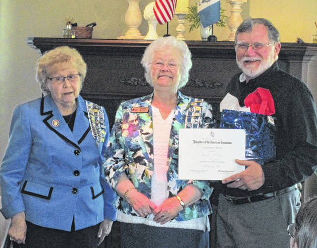 Regent Frances Sharp and Judy Sargent present the Community Service Award to Randy Riley.